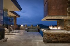 Luxury modern seashore villa with 3 sided see through gas fireplace