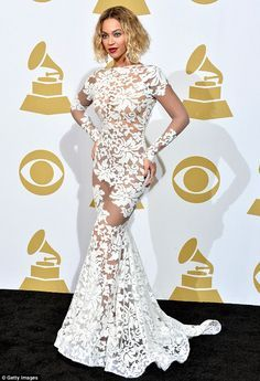 Beyonce wore a jaw-dropping Michael Costello Couture white lace dress at the Grammys