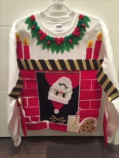 Santa Claus is coming down the chimney tonight. Santa Claus is coming down the . Read more The post DIY Ugly Christmas Sweater. Santa Claus is coming down the chimney Couple Christmas, Noel Christmas, Christmas Crafts, Ugly Sweaters Diy, Xmas Sweaters, Ugly Sweater For Kids, Mohair Cardigan, Best Ugly Christmas Sweater, Ugly Christmas Jumpers
