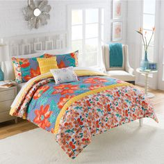 Upgrade your bedroom with this floral comforter set, crafted of quality polyester. The bold colors are sure to accent your existing decor. This set is conveniently machine washable.