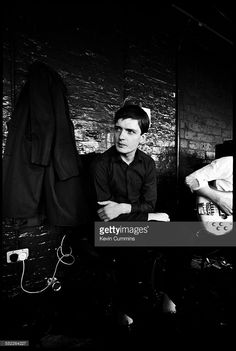 Singer Ian Curtis (1956 - 1980) of rock group Joy Division, at TJ Davidson's rehearsal room, Little Peter Street, Manchester, 19th August 1979. On the right is guitarist Bernard Sumner.