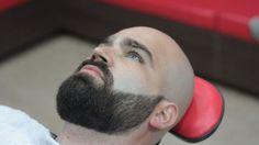 Shaved head w trimmed beard