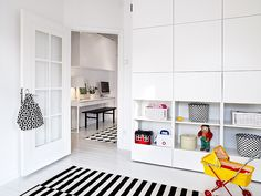 again white with black and bright pops of color. love the clean white storage up top