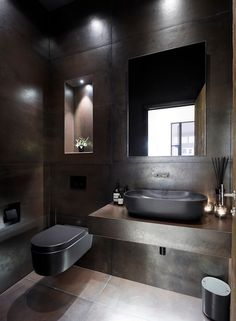 dark bathroom A stunning Gents cloakroom with dark bronze effect tiles and black bathroom fittings. Mirror cabinet for storage and Lutron lighting. Grey Bathroom Tiles, Dark Bathrooms, Bronze Bathroom, Bathroom Fixtures, Bathroom Design Inspiration, Bad Inspiration, Small Toilet Room, Small Bathroom, Pool Bathroom