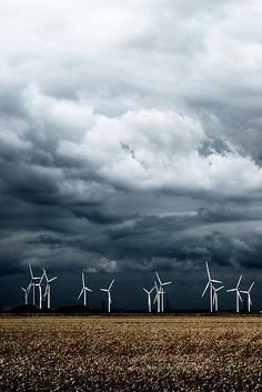 Wind turbines,Dungeness, Kent, England,UK  .LOVE those dark clouds.