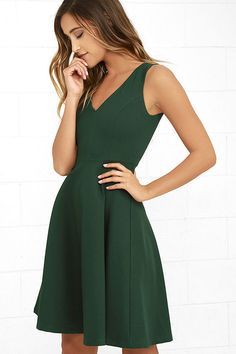 Welcome the Hello World Dark Green Midi Dress into your heart and your wardrobe! Medium-weight stretch knit forms a sleeveless bodice with a V-neckline and princess seams. A flirty midi-length, skater skirt falls from the fitted waist. Hidden back zipper/clasp.
