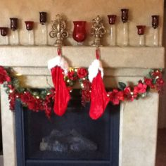 I made this Christmas swag with flowers from my wedding! Christmas mantle. Stocking above fire place