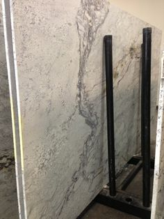 Kasmir white granite alternative to white carrara for for Carrara marble slab remnants