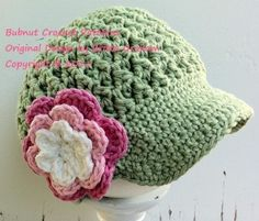News boys hat with cute flower...: http://crocheting.myfavoritecraft.org/crochet-flower-patterns/