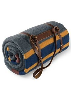 Leather Blanket Carrier, a great way to make a blanket into a travel blanket for picnics, car trunks, or camping.