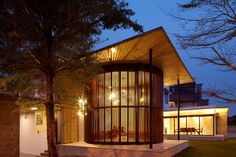 Evening View as Interior Design Patio Modern Style Covered By Wooden Blind Wall under Round Shape Beside Tree