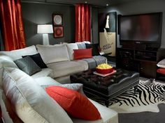 Brown tan neutrals Home movie Media Room Candice Olson transforms a small basement space into a movie theater. Dark gray walls are perfect for movie night. The white sectional, red accents and ample lighting keep the space from feeling dark and drab. Living Room Red, Living Room Decor, Black And Red Living Room, Black House, Living Room Interior, Interior Design Living Room, Rooms Decoration, Basement Family Rooms, White Sectional