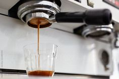 Close-up of espresso pouring in glass by Martí Sans for Stocksy United