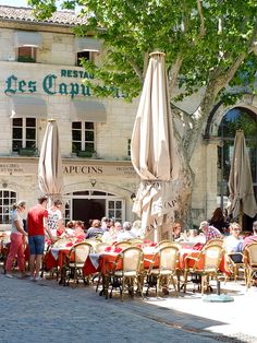 Aigues-Mortes ~ LUNCH ... and colored sheep hanging from the city gates ~ 2008