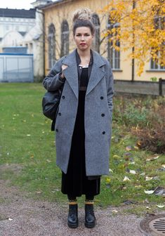 """""""I'm wearing two Weekday coats on top of each other, a second hand top and skirt, Vagabond shoes and old woollen socks which I've had since kid.At the moment I like ankle-long dresses and coats, zips and snaps."""""""