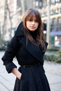 A fancy twist to the classic black coat. Look at those seams!