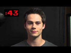 Dylan O'Brien staring at the camera, trying not to laugh :)