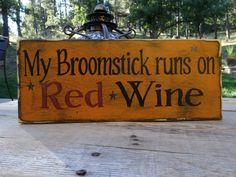 My Broomstick runs on Red Wine hand painted wood sign. This Halloween sign would add some fun to any area of the home... Made with wine and