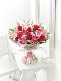 Valentines Rose and Lily Hand Tied. Beautiful flowers for your beautiful beloved.