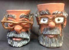 Face Mugs, cartoon versions of Dave the Potter. Cone 6 with underglazes and clear glaze