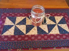 Country Colors Quilted Table Runner/ Scrap Quilt Pinwheel Pattern Burgundy, Navy,and Beige by RubysQuiltShop on Etsy