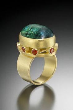 Sam Woehrmann: 22 / 18k gold, green tourmaline, orange sapphires