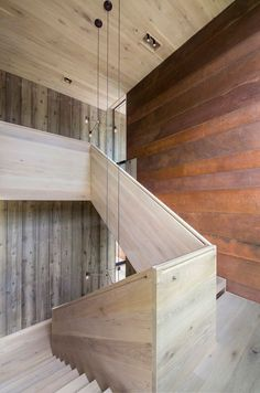 vertical and weathered wood siding adorning the minimalist staircase                                                                                                                                                                                 Plus