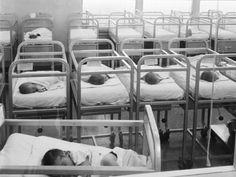 Vintage photo of a hospital newborn nursery.