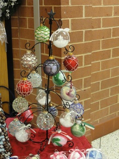 Love the beaded ornaments... might have to attempt these for my yearly Christmas bulb