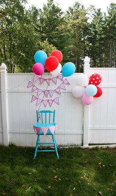 Pink and aqua first birthday smash cake highchair setup
