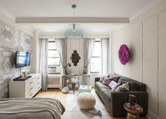Small Studio Apartment Decorating Tips: Rather than paint, use small pops of color to keep the space looking open.