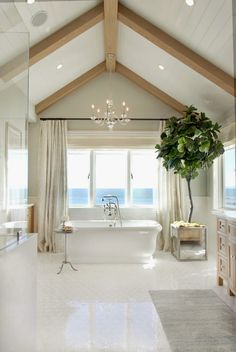 House of Turquoise: Bliss Home and Design. White bathroom with vaulted ceiling and cool fiddle-leaf fig plant (tree?).