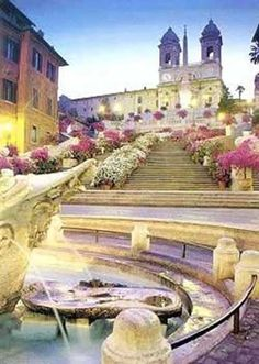 Spanish Steps  (Scalinata della Trinità dei Monti)  -  Rome, Italy  -  1723-1725  -  137 steps in 12 irregular flights linking the beautiful Piazza de Spagna (Spanish Square named after the Spanish Embassy to the Holy See) at the bottom  the 1500s French Church, Trinta dei Monti,  at the top
