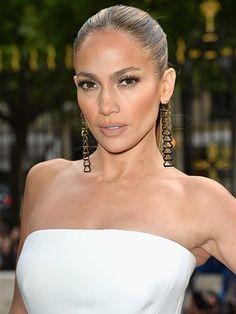 Jennifer Lopez's sleek high ponytail with bold brows, bronzed cheeks and flirty eyelashes | allure.com