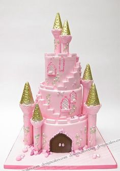 Pink and gold castle cake