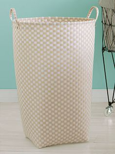 Woven     Hidden steel inserts keep this tone-on-tone nylon vessel standing tall. ($39.99; containerstore.com)