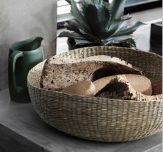 A handwoven seagrass basket filled with pot stands in cork.