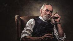 senior-businessman-sitting-in-chair.jpg (2000×1125)