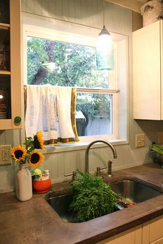 Flour sack curtain. Beadboard backsplash looks good with concrete counters