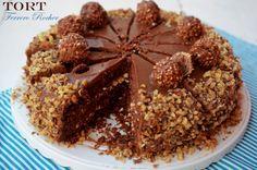 Tort ferrero rocher cu ciocolata si alune de padure.
