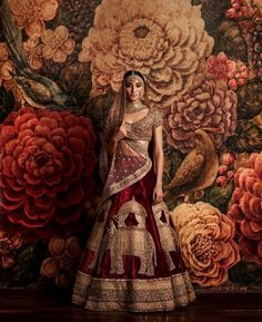 Bridal Lehengas - Marsala and Gold Wedding Lehenga | WedMeGood | Sabyasachi Bridal Lehenga with Elephant Gold Caricatures and Net Gold Dupatta #wedmegood #indianwedding #indianbride #sabyasachi #marsala #lehenga #bridal