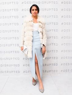 Meghan Markle in a light blue maxi skirt and a white fur