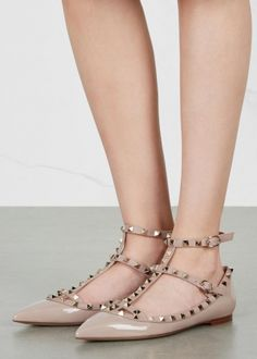 Valentino blush patent leather flats Pale gold stud embellishments, grained leather T-bar strap and trims, pointed toe Buckle-fastening ankle straps Come with a dust bag
