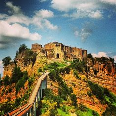 """See 587 photos and 48 tips from 1956 visitors to Civita di Bagnoregio. """"One of the most incredible places I've ever been. Cypress Trees, Pedestrian Bridge, Reinforced Concrete, Far Away, The Locals, Tuscany, Mother Nature, Monument Valley, Countryside"""