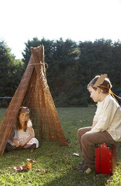 Really great ideas for a Native American Themed Kids' Party: cardboard canoe, river, paper bag vests.