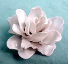 plastic spoons rose pin.  Go to http://www.cutoutandkeep.net/projects/plastic-spoon-rose   to find instructions