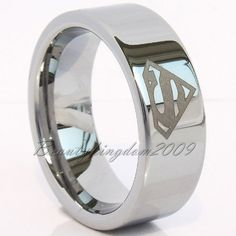 I like this....wedding band with a superhero logo on it. This will most likely happen on my wedding. ^_^