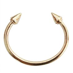"""Simple with a lil' edge the On Point Spike Bangle Bracelet looks great alone or paired with other bangles.   Material: Alloy Color: Gold Diameter: Approx. 2. 3"""""""