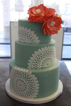 Gorgeous green/blue tiered wedding cake with lace accents and pink gumpaste flowers.  Fondant Cakes « Sweet & Saucy Shop