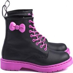 Dr Martens / Sanrio.  Black body with pink soles and laces.  Hello Kitty bow.